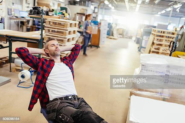 man having break at work - hands behind head stock pictures, royalty-free photos & images