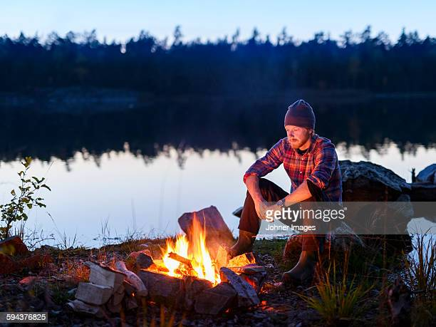 Man having campfire