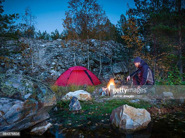 man having campfire - dalsland stock photos and pictures