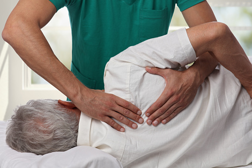 Man having chiropractic back adjustment. Osteopathy, Alternative medicine, pain relief concept. Physiotherapy, sport injury rehabilitation 849268638
