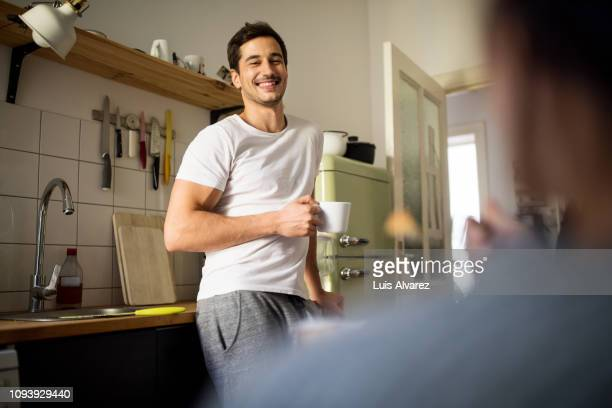 man having coffee at home in morning - mid adult men stock-fotos und bilder