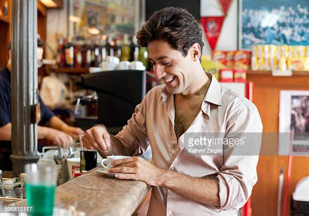 man having coffee at the bar, laughing