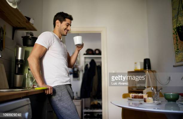man having coffee in morning at home - nightdress stock pictures, royalty-free photos & images