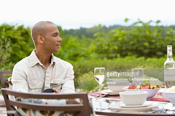 "man having dinner outside on a patio. - ""compassionate eye"" - fotografias e filmes do acervo"