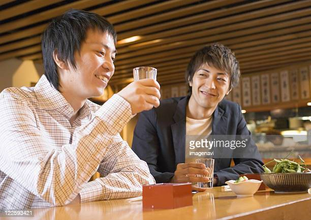 Man Having Drinks in Japanese Style Pub