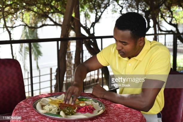 Man having Ethiopian food