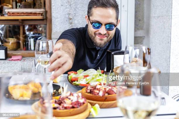 Man Having Food At Restaurant