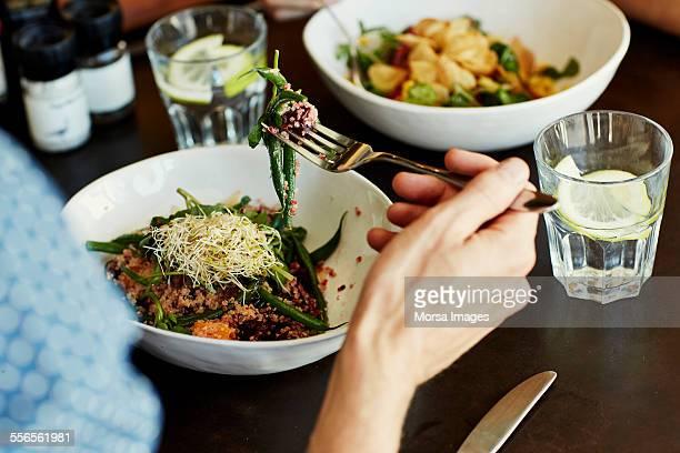 Man having food at restaurant table