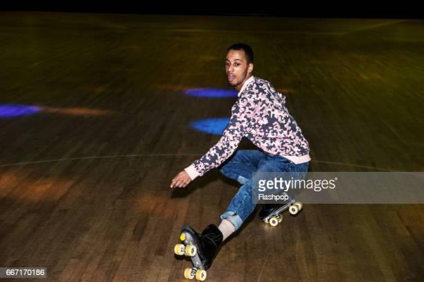 man having fun at roller disco - showing off stock photos and pictures