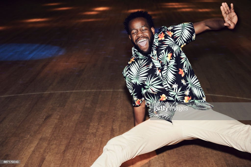 Man having fun at roller disco : Stock Photo