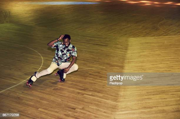 man having fun at roller disco - roller rink stock photos and pictures