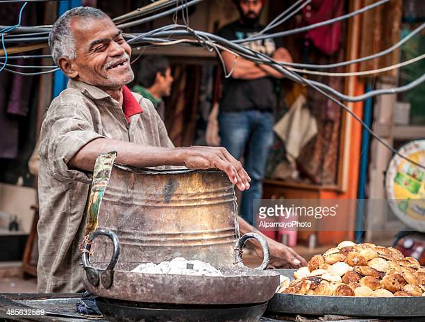 man having fun at the old delhi street market - old delhi stock pictures, royalty-free photos & images