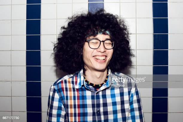 man having fun on evening out - bad hair stock pictures, royalty-free photos & images