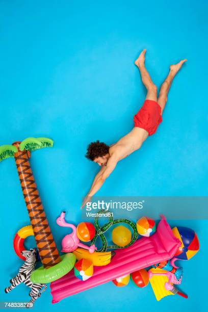 Man having fun on his vacation, jumping into the water