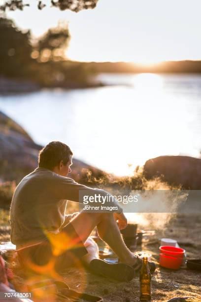 Man having grill by lake