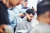 man having hair cut barber shop