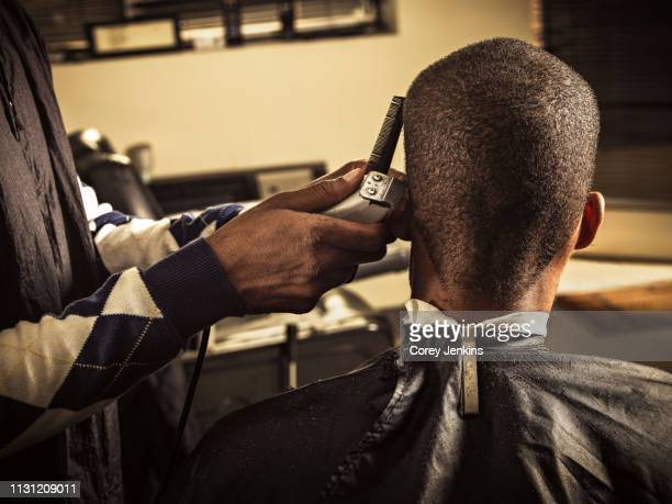 man having haircut at barber shop - barber stock pictures, royalty-free photos & images