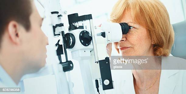Man having his eyes examined.