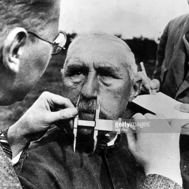 Man having his nose measured during Aryan race determination tests under Nazi Germany's Nuremberg Laws that was applied to determine whether a person...
