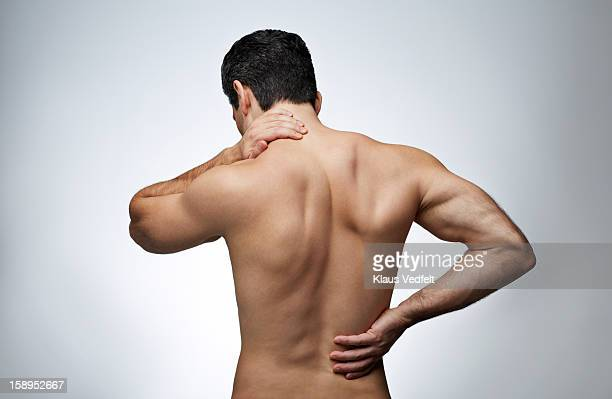 Man having neck pain & back pain (rear view)