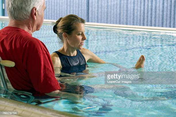 Man having physical therapy in pool
