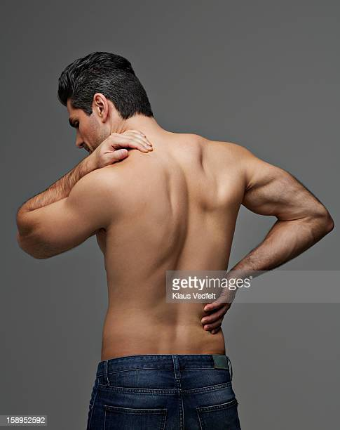Man having shoulder & back pain (rear view)