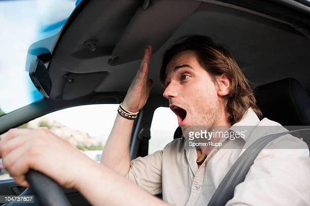 Man having stress in traffic