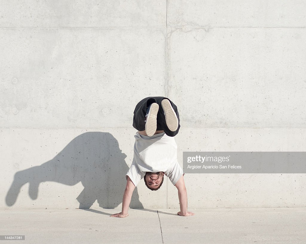 Man head down and leg up : Stock Photo