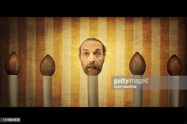 man head on coconut shell - scott macbride stock pictures, royalty-free photos & images