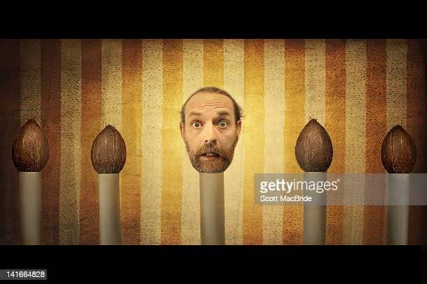 Man head on coconut shell