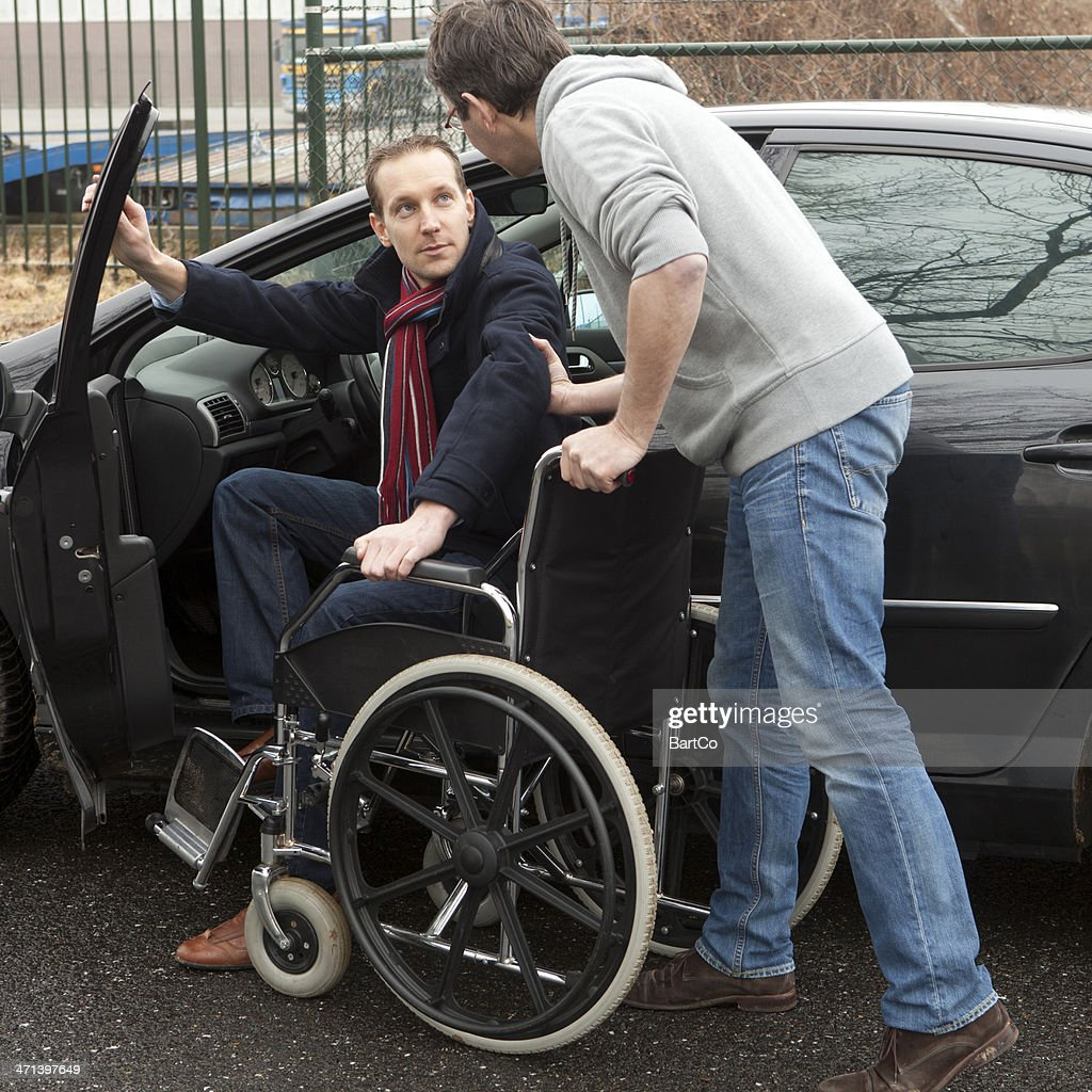 Man Helping A Disabled Person Stock Photo Getty Images