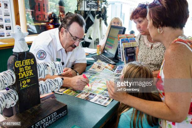 Man helping a family in the Visitor Information Center in Saint Augustine.