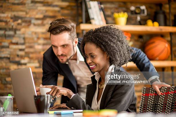 Man helping to female colleague