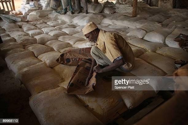 Man helps to distribute flour at a United Nations food distribution center in Dadaab, the world�s biggest refugee complex August 20, 2009 in Dadaab,...