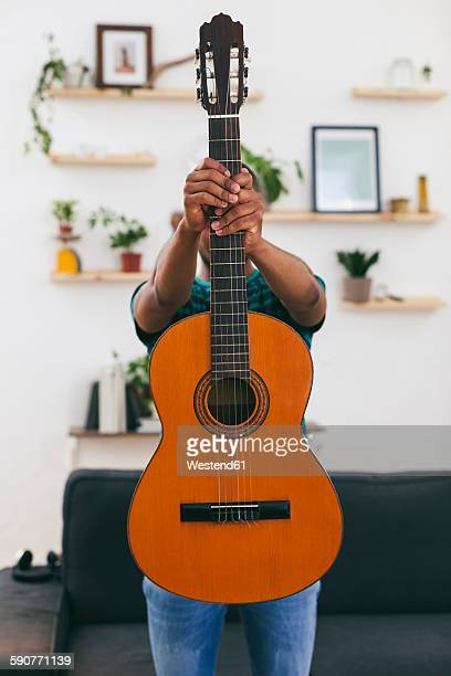 man hiding behind a guitar - obscured face stock pictures, royalty-free photos & images