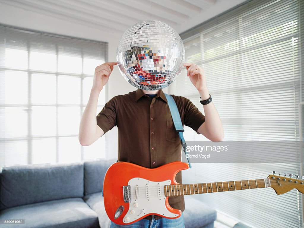 Man hiding behind disco ball : Stock Photo