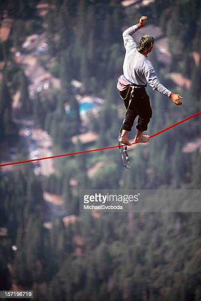 man high lining - yosemite valley stock photos and pictures
