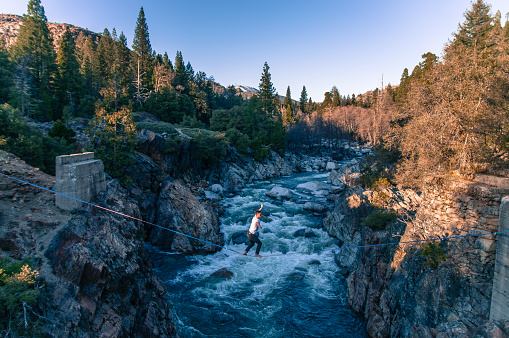 Man highlining above river, Truckee, California, USA - gettyimageskorea