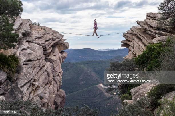 Man highlining between rocky cliffs, El Garbi, Valencia, Spain