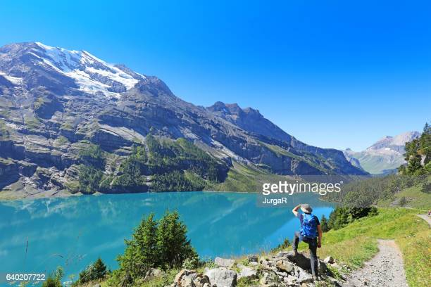 Man Hiker Admiring the  Mountain Scenics in the Swiss Alps