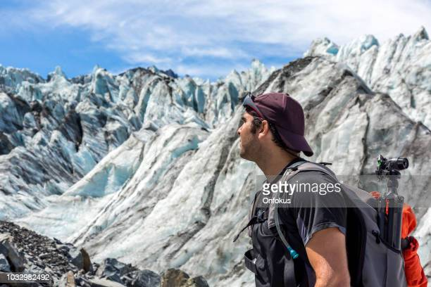 Man Hiker or Photographer with Mountain and Fox Glacier Background in New Zealand
