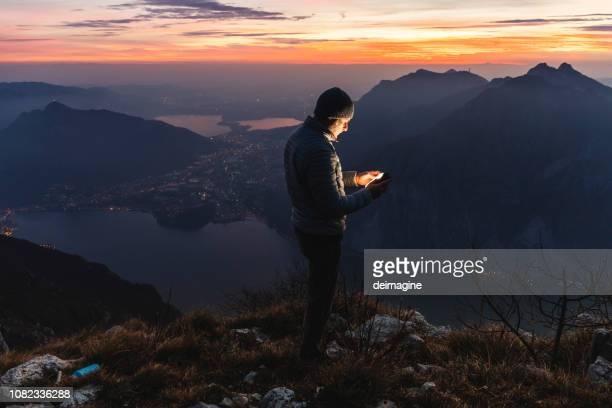 man hiker solo on the mountain during golden hour - exploration stock pictures, royalty-free photos & images