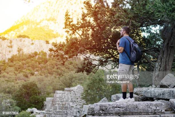 Man Hiker with backpack enjoying view