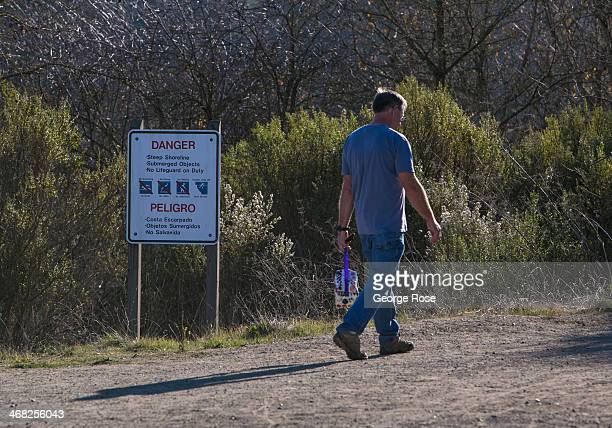 Man hikes along the Russian River at Riverfront Regional Park on January 25 in Healdsburg, California. With 2013 the driest year in recorded history...
