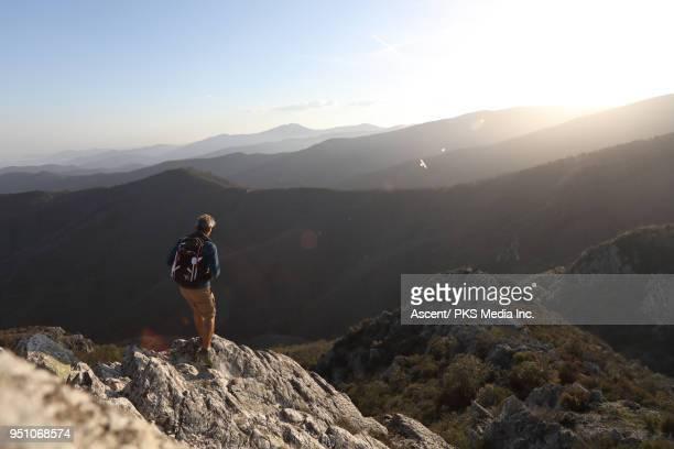 Man hikes up high mountain ridge