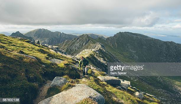 Man hiking along Mountain ridge in Scotland