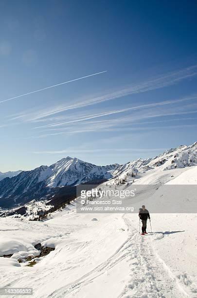Man hiking alpine valley in Valle d'Ao