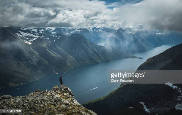 man hiking amazing nature in norway. - scandinavian ethnicity stock pictures, royalty-free photos & images