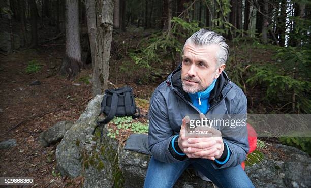 Man hiking and having a cup of coffee