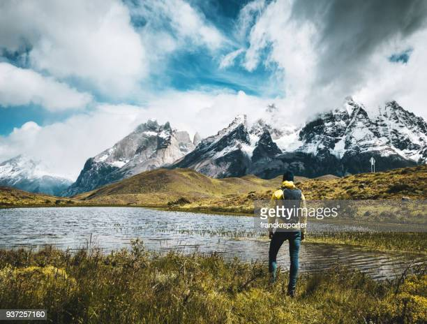 man hiking at torres del paine - chile - patagonia chile stock photos and pictures
